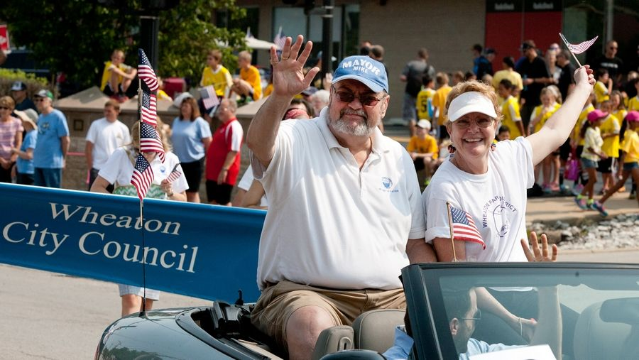 Wheaton Mayor Michael Gresk waves to the crowd during an Independence Day parade. This year's parade will begin at 10 a.m. Monday, July 4, at Hawthorne Boulevard and Main Street.