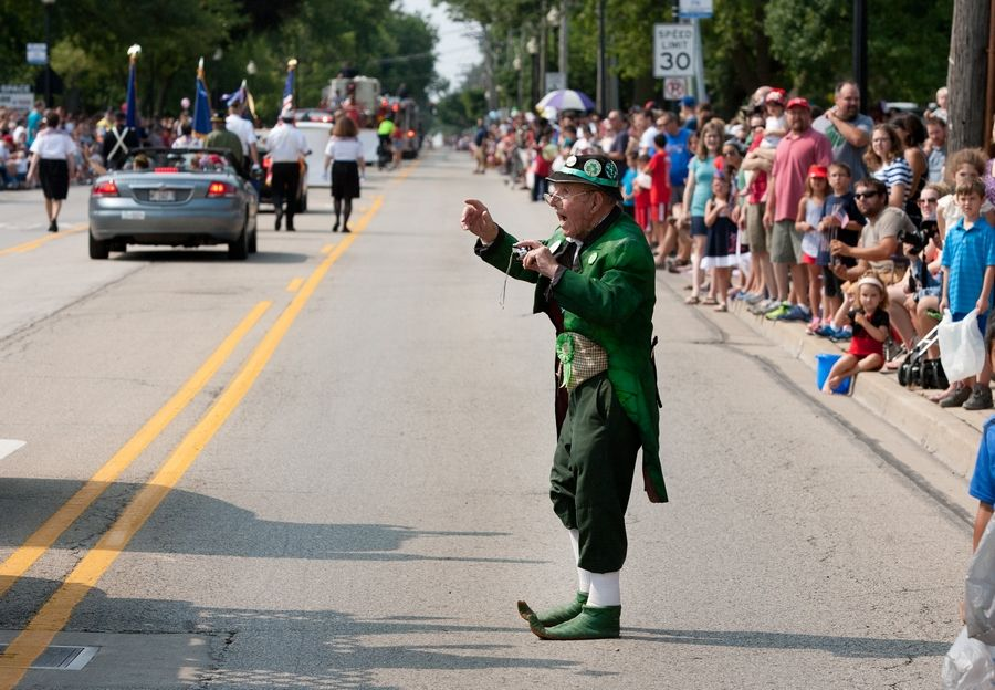 Wheaton's Bernie Hurley, dressed in Irish attire, takes photos during a Wheaton Independence Day parade. The parade is part of a two-day celebration of the Fourth of July that begins Sunday, July 3, with family activities and fireworks in Graf Park. The parade begins at 10 a.m. Monday, July 4.