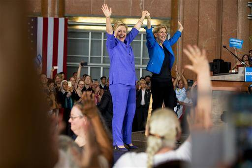 Democratic presidential candidate Hillary Clinton, accompanied by Sen. Elizabeth Warren, D-Mass., arrives to speak at the Cincinnati Museum Center at Union Terminal in Cincinnati, Monday, June 27, 2016. (AP Photo/Andrew Harnik)