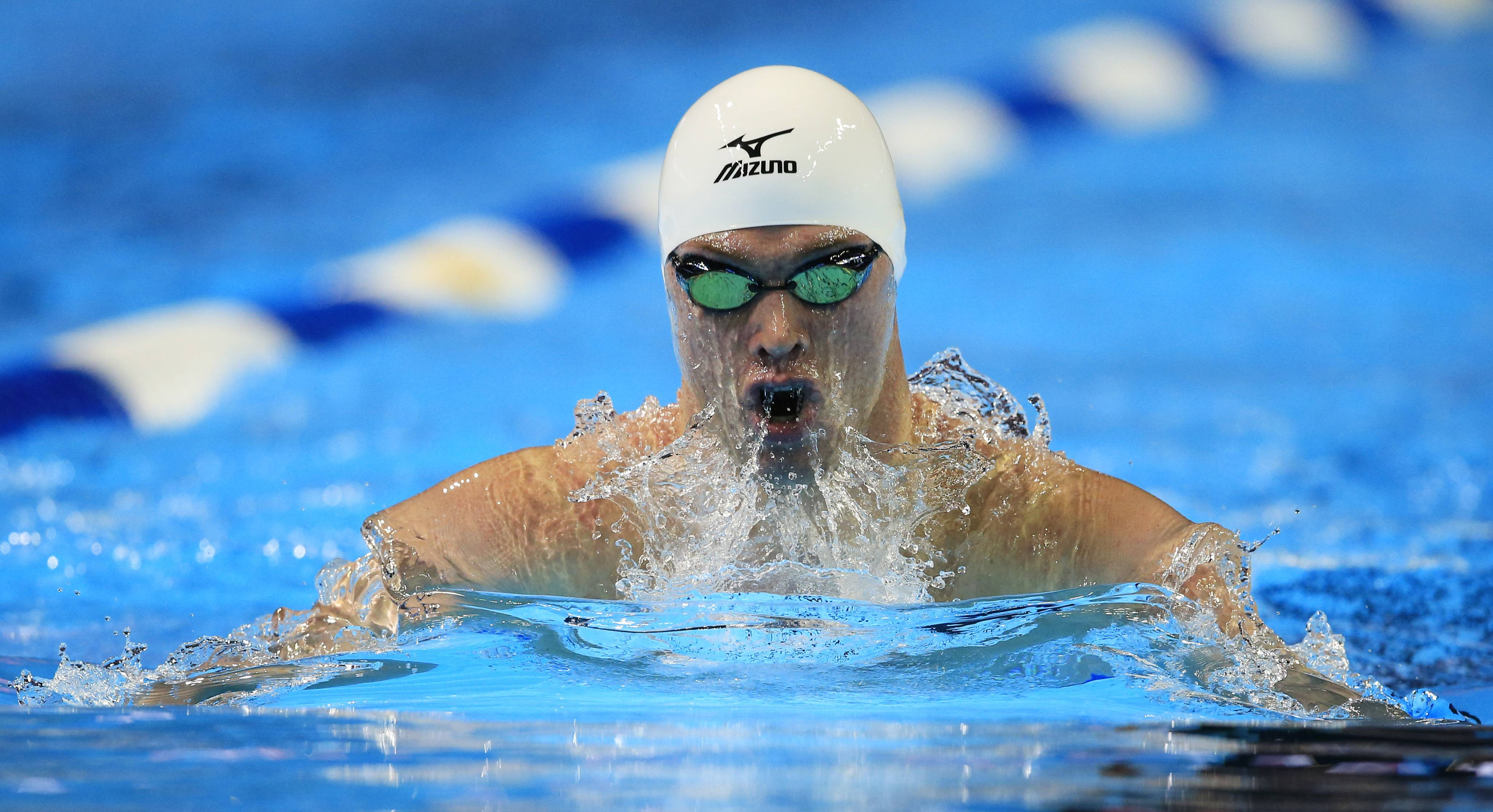 Kevin Cordes Heads For The Top Qualifying Time In The 200 Meter Breaststroke  At The