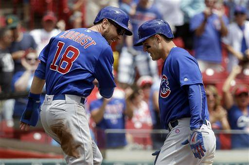 Chicago Cubs' Anthony Rizzo, right, celebrates with Ben Zobrist (18) after hitting a three-run inside the park home run off Cincinnati Reds starting pitcher Cody Reed in the first inning of a baseball game, Wednesday, June 29, 2016, in Cincinnati. (AP Photo/John Minchillo)