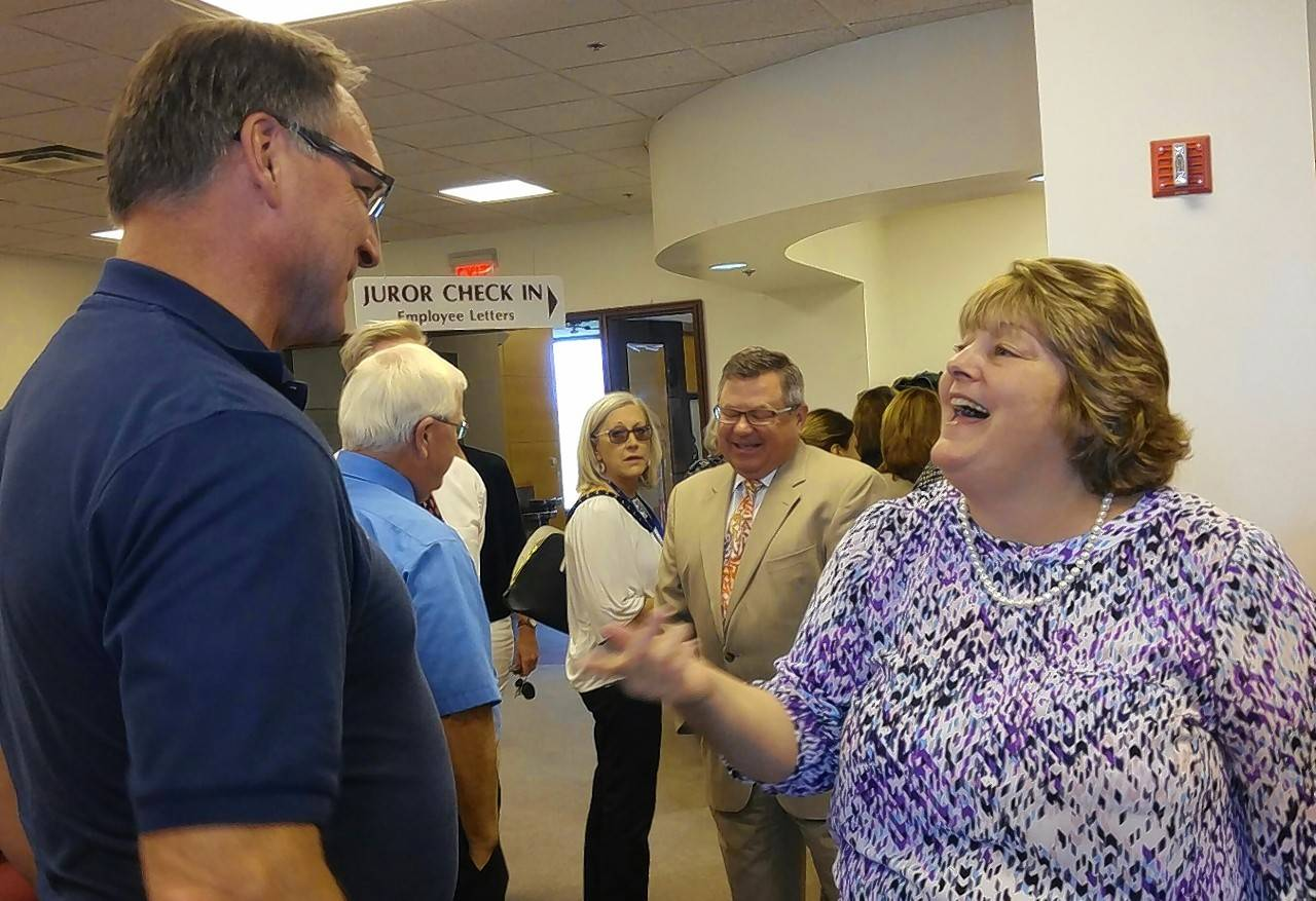 Retiring Kane County Circuit Judge Judith Brawka chats with Sheriff Don Kramer Thursday during a retirement reception for her and Judge Thomas Mueller.