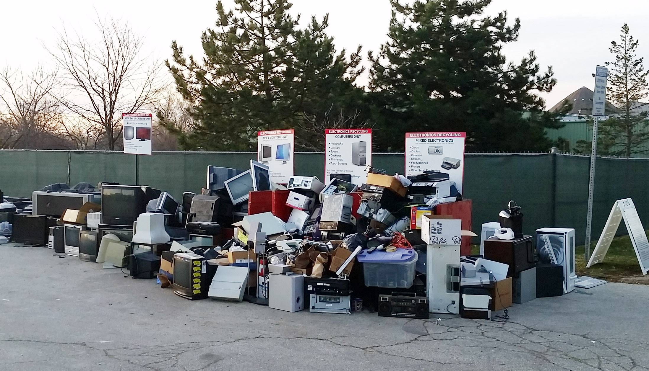 Electronics are piled up before being removed from the electronics collection site in Grayslake