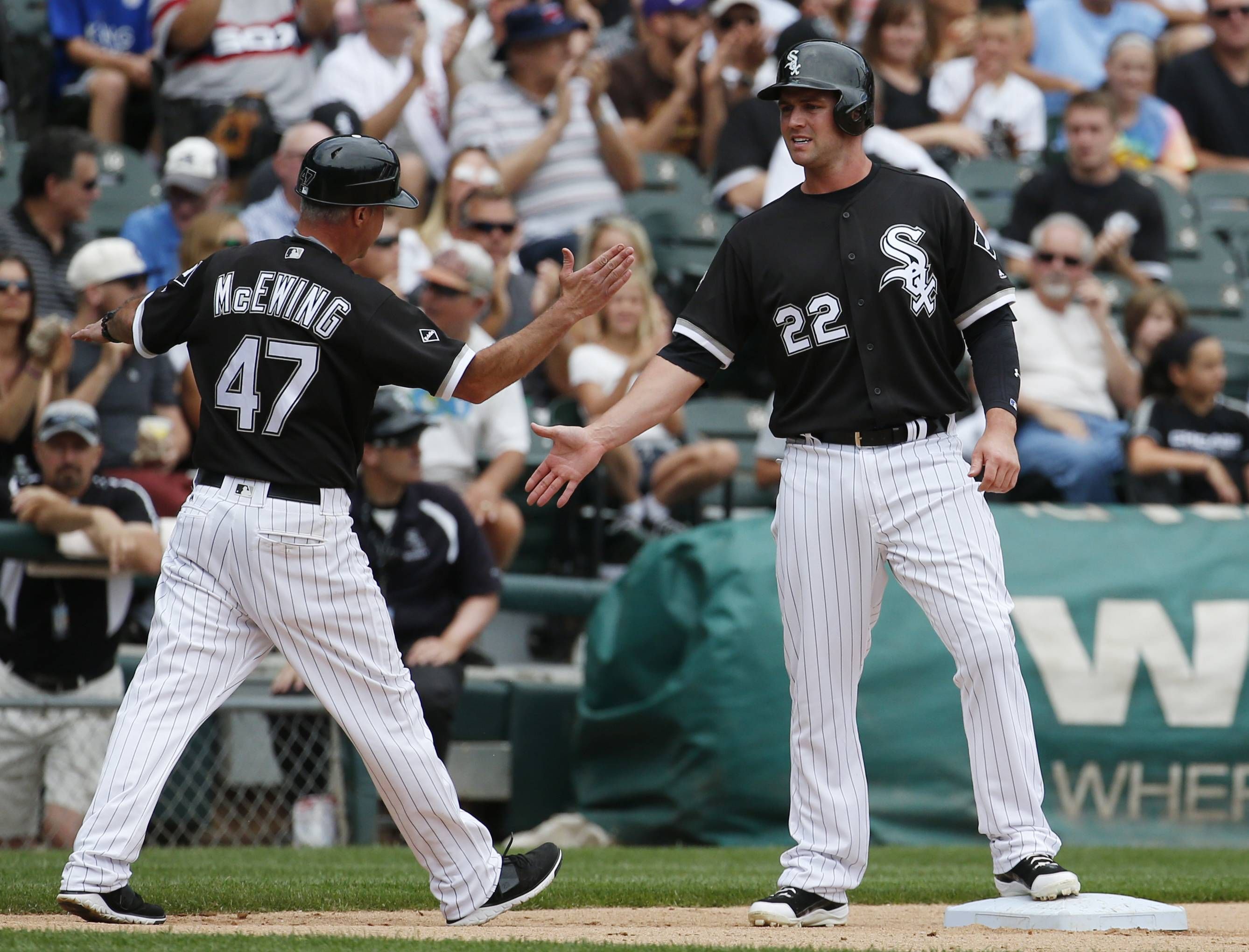 Chicago White Sox's Matt Davidson, right, celebrates with third base coach Joe McEwing as he arrives at third base after J.B. Shuck hit a double against the Minnesota Twins during the fourth inning of a baseball game in Chicago, Thursday, June 30, 2016.