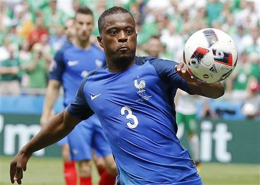 France's Patrice Evra eyes the ball during the Euro 2016 round of 16 soccer match between France and Ireland, at the Grand Stade in Decines-­Charpieu, near Lyon, France, Sunday, June 26, 2016. (AP Photo/Laurent Cipriani)