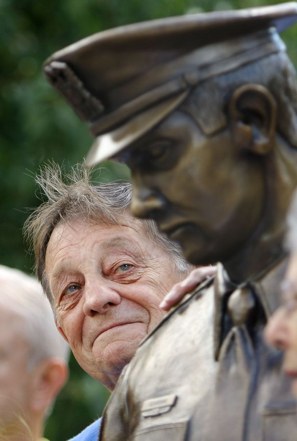 Jack Forshaw, chairman of the police statue fund committee looks fondly at the statue that he helped champion, during a dedication ceremony at the Mundelein Police Department Friday morning.