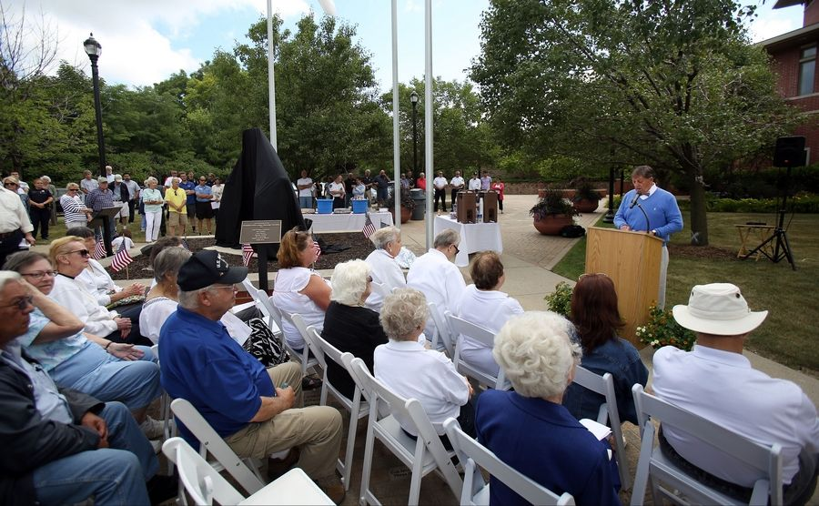 Jack Forshaw, chairman of the police statue fund committee speaks during a dedication at the Mundelein Police Department Friday morning.
