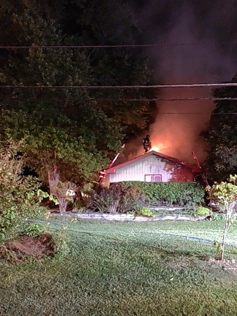 A house attic fire in Des Plaines Friday morning was triggered by hot coals that fell onto a wooden deck, authorities said.