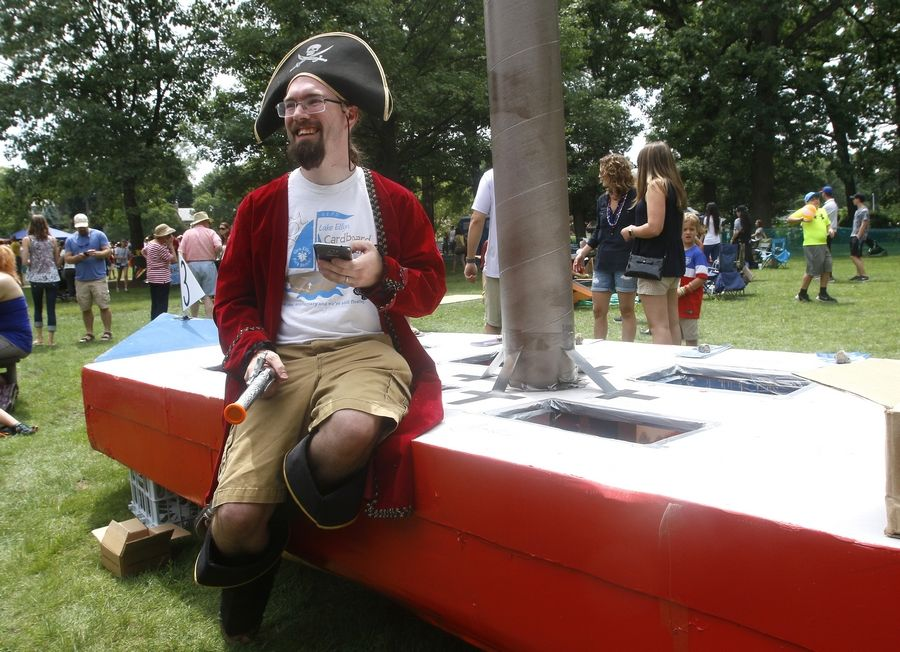 "James Hommowun of Glen Ellyn prepares his boat ""Independence""  for the Lake Ellyn Cardboard Boat Regatta."
