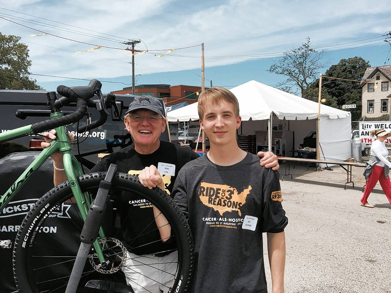 "Bob Lee of Barrington, left, is passing the torch of his ""Ride for 3 Reasons"" cross-country bicycle treks to raise money for three charities on to 17-year-old Jan Gierlach. The Barrington High School student will graduate early in December so he can make the ride from San Diego to St. Augustine, Florida next year."