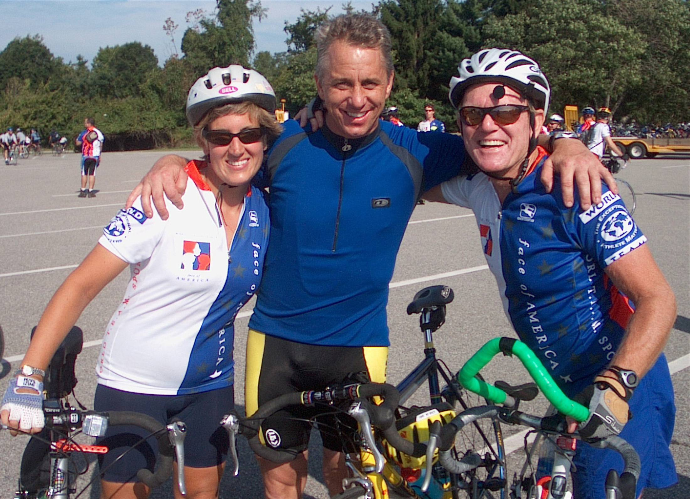 Bob Lee, right, has made three cross-country bike rides to raise money for charity. Here he and fellow Barrington resident Amy Kenrich take a break from one of the rides to meet with Tour de France champion Greg LeMond.