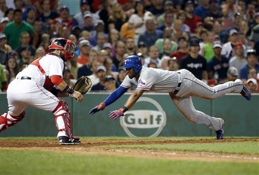 Texas Rangers' Elvis Andrus, right, scores on a double by Rougned Odor as Boston Red Sox's Sandy Leon waits for the throw during the sixth inning of a baseball game in Boston, Tuesday, July 5, 2016.