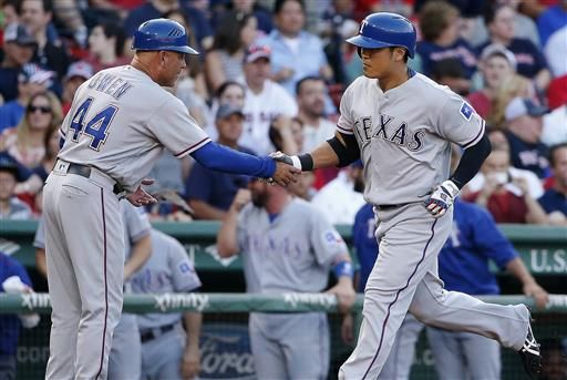 Texas Rangers' Shin-Soo Choo, right, celebrates with third base coach Spike Owen (44) on his solo home run during the first inning of a baseball game against the Boston Red Sox in Boston, Tuesday, July 5, 2016.