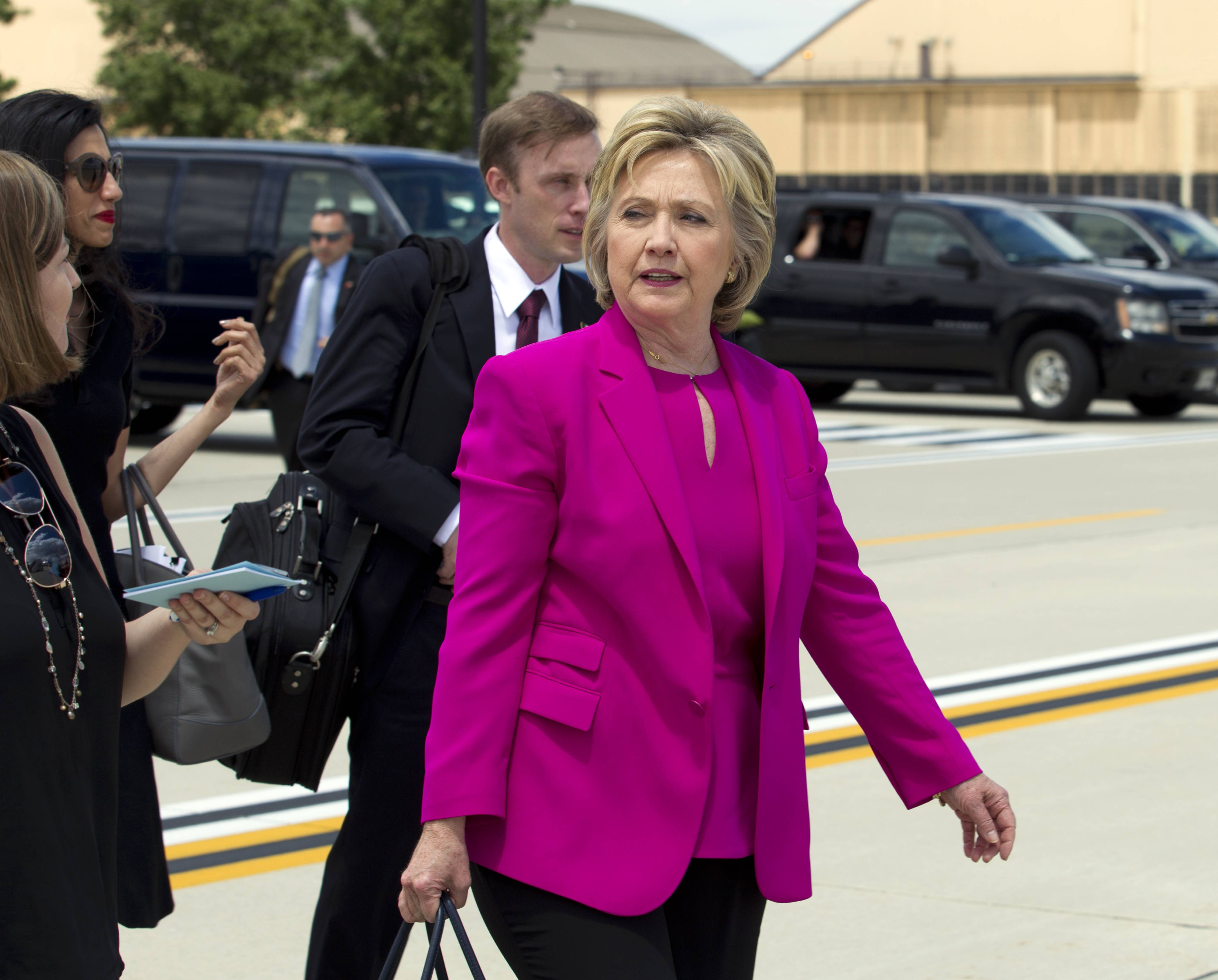 Democratic presidential candidate Hillary Clinton arrives to board Air Force One at Andrews Air Force Base, Md., Tuesday, to campaign with President Barack Obama.