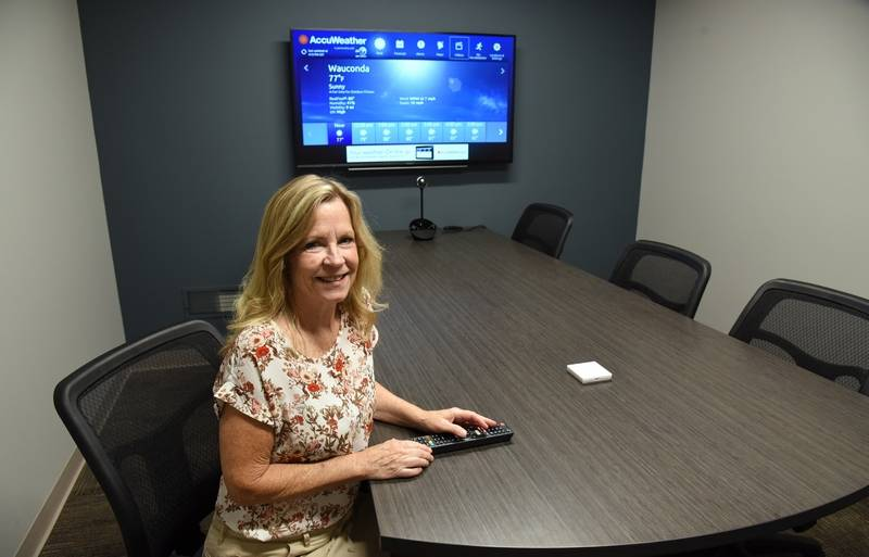 tamaracks diane mcnulty sits in the newly remodeled conference room at the wauconda business - Office Makeover Contest