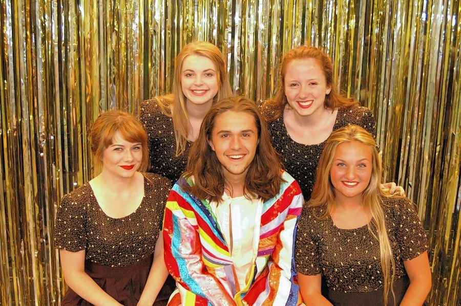 "Gabriel Harder, as Joseph, is surrounded by narrators, clockwise from lower left, Allison Elkins, Lucy Hauser, Kate Jarecki and Abbey Loria in the Fox Valley Park District's production of ""Joseph and the Amazing Technicolor Dreamcoat."""