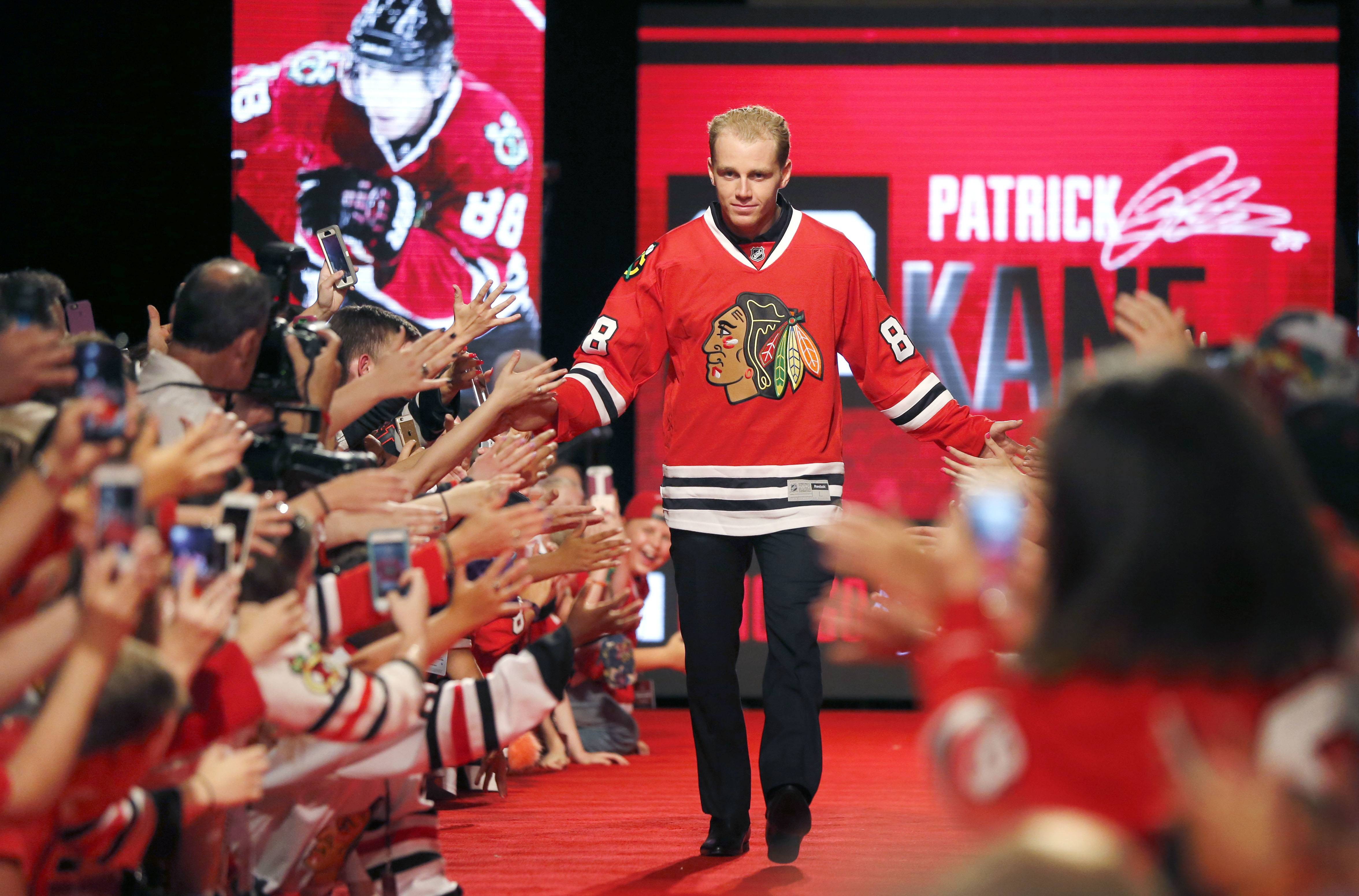 Chicago Blackhawks' Patrick Kane is introduced to the fans during the Blackhawks' NHL Convention Friday, July 15, 2016, in Chicago.