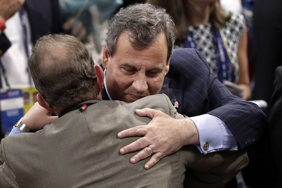 Gov. Chris Christie of New Jersey greets delegates on the floor during the opening day of the Republican National Convention in Cleveland.