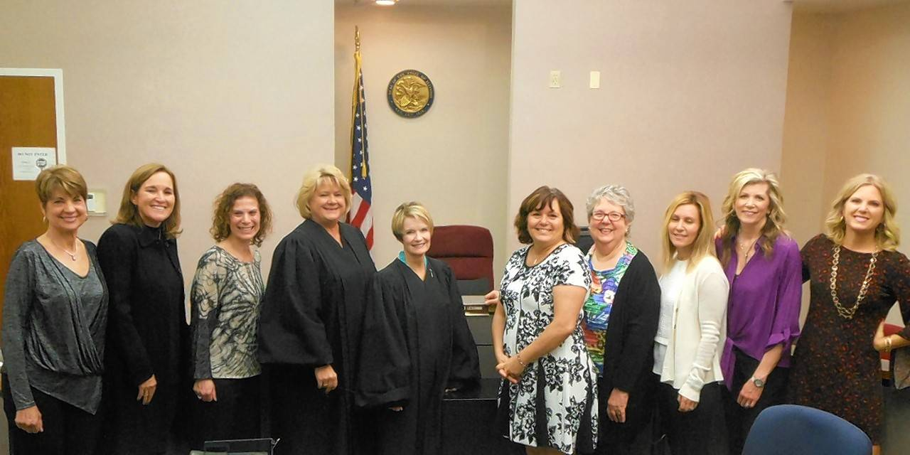Ten volunteers were recently sworn in as Court Appointed Special Advocates. From left: Sue Sherman of Lake Barrington, Jenny Frentzel of Wilmette, Jodi Kahn of Riverwoods, Judge Valerie Boettle Ceckowski, Lake County Juvenile Court Judge Sarah P. Lessman, Teresa Kick of Round Lake Beach, Sharon Gernady of Glenview, Missy Kanter of Deerfield, Heidi Raymond of Palatine and Kerri Melzl of Northfield; not pictured: John Brignon of Vernon Hills and Mary Dominiak of Antioch.