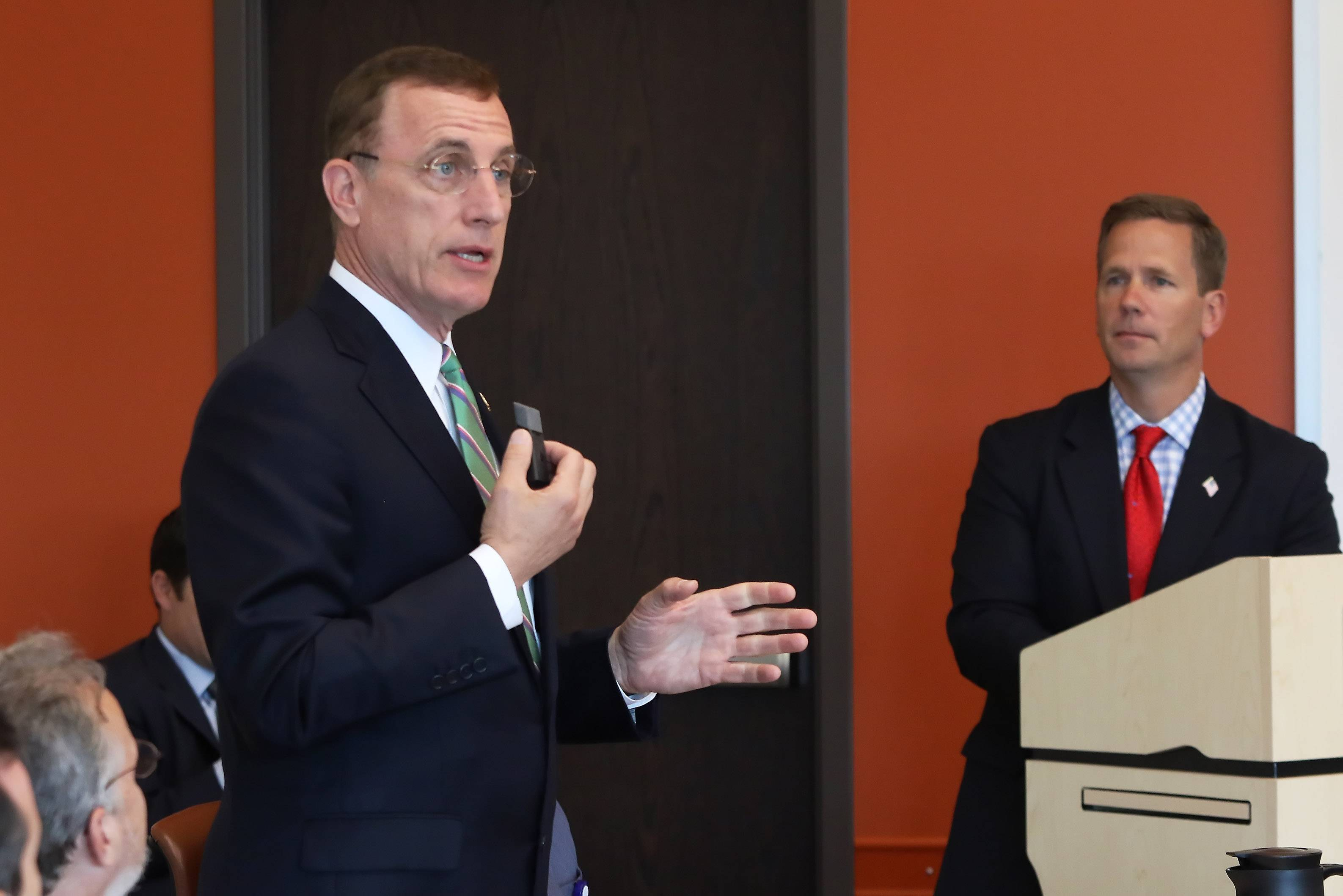 Congressmen Tim Murphy of Pennsylvania, left, and Bob Dold of Kenilworth discuss the Helping Families in Mental Health Crisis Act on Tuesday during a summit at the Lake County Health Department in Waukegan.