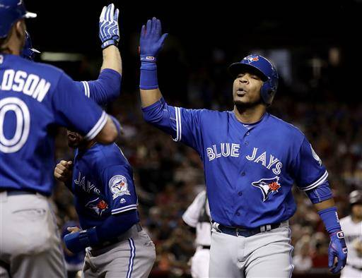 Toronto Blue Jays' Edwin Encarnacion high fives teammates after hitting a three-run home run against the Arizona Diamondbacks during the third inning of an interleague baseball game, Tuesday, July 19, 2016, in Phoenix. (AP Photo/Matt York)