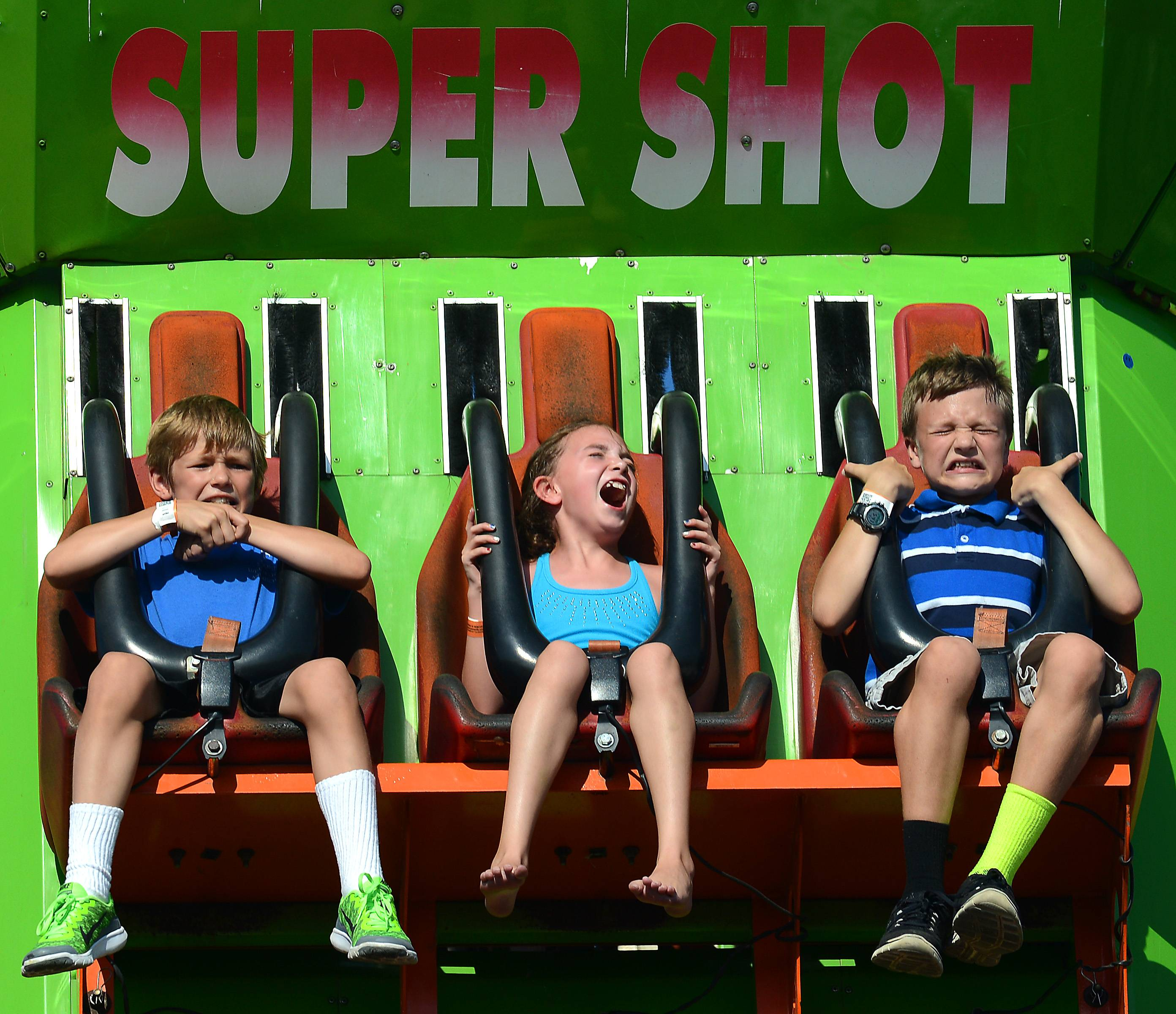 It was all tight grips and screams on the Super Shot for Nolan Scheel, 11, of Batavia, left, Brianna Siercks, 9, of St. Charles, center, and Ben Feuerborn, 12, of Batavia during opening day of the Kane County Fair in St. Charles Wednesday.