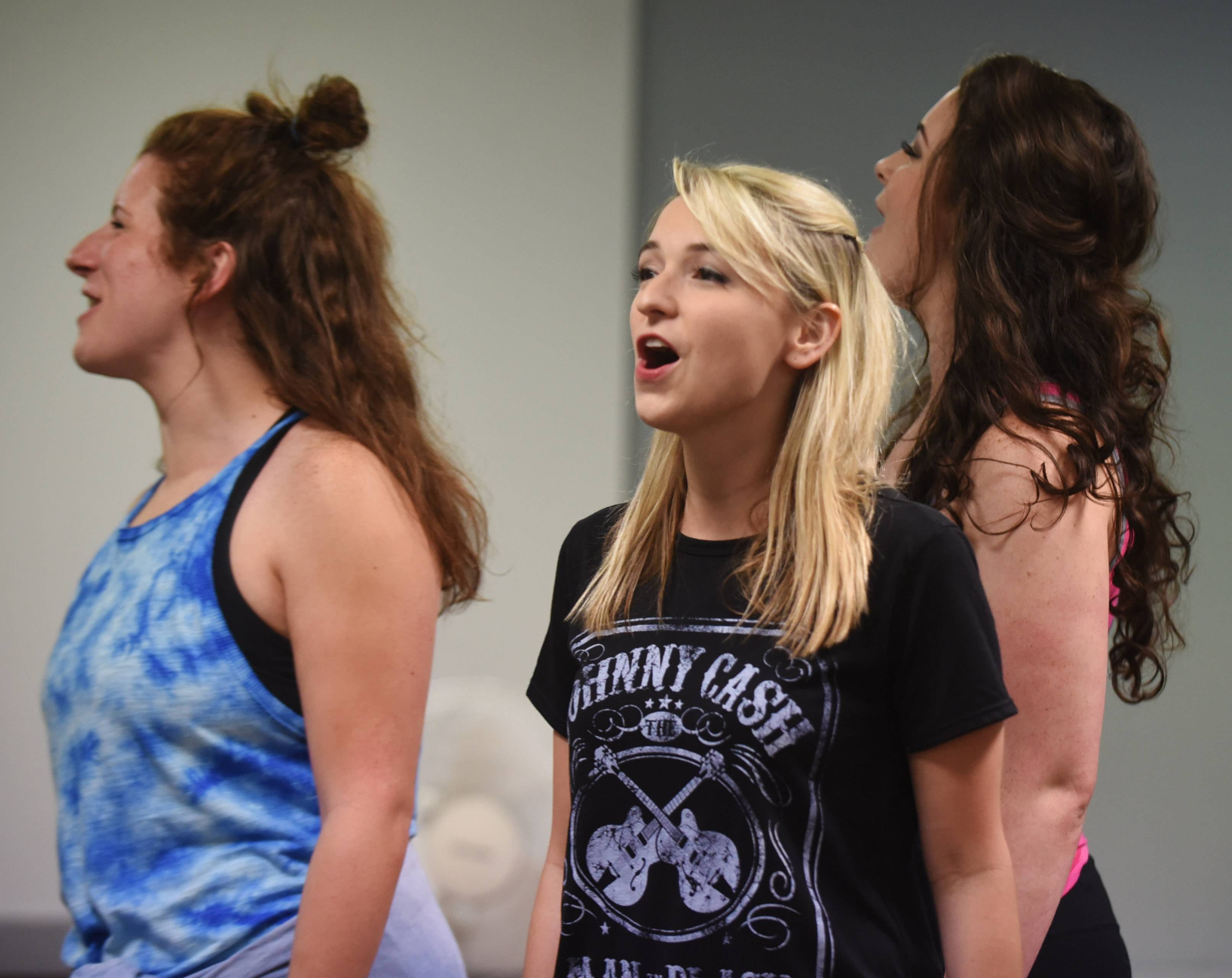 "From left, Abby Vombrack, Jenna Payne and Brandy Miller rehearse for the Johnny Cash musical ""Ring of Fire"" at the Metropolis Performing Arts Centre. Payne is a Maine West High School graduate who recently landed the role of ""young"" June Carter Cash in the musical."