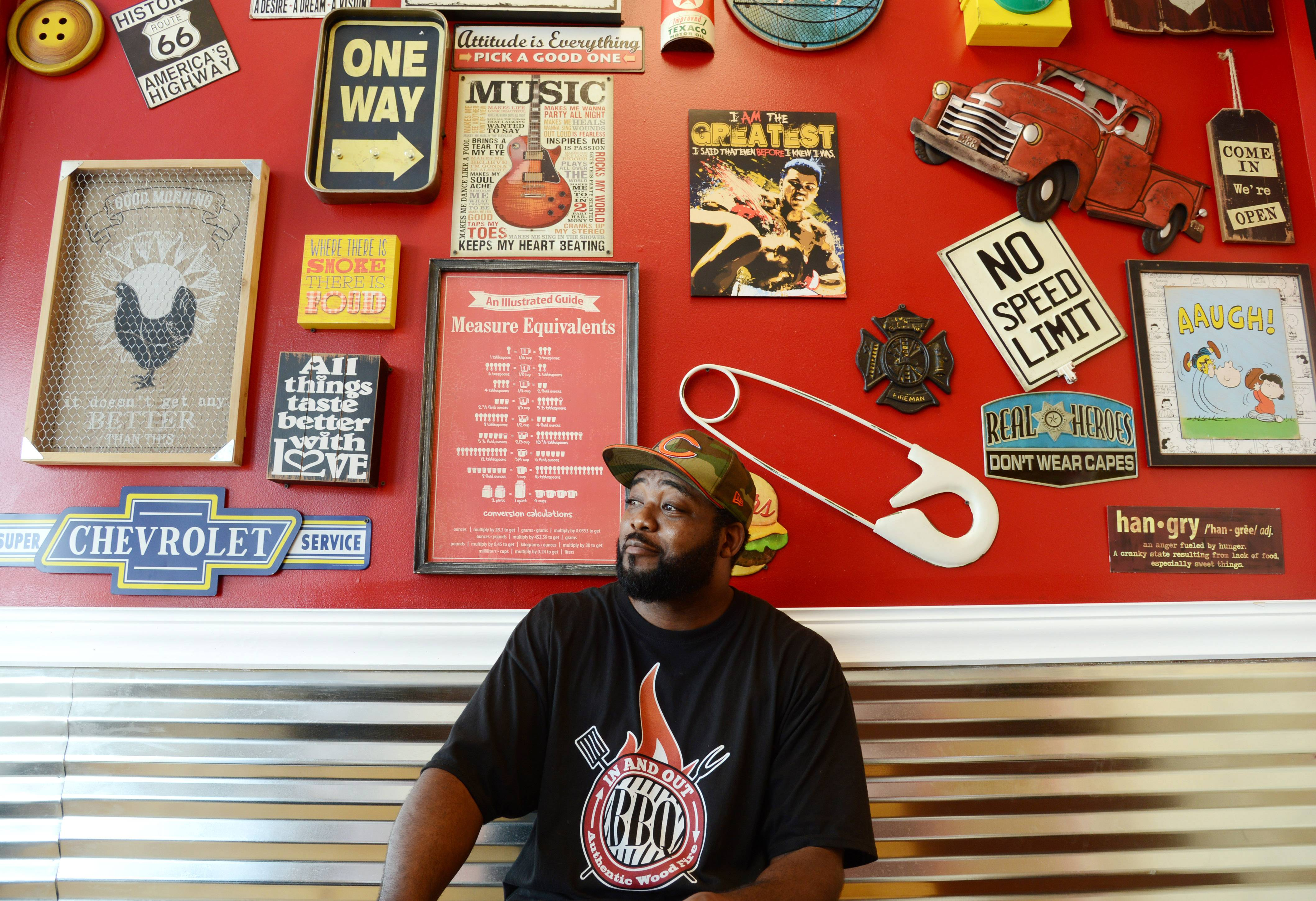 Quinton Beal at his In and Out BBQ restaurant, at Hawley and Lake streets in Mundelein. He and village officials hope the eatery helps lead a resurgence of the struggling Hawley Lake Plaza. The restaurant opened earlier this month but hopes to celebrate a grand opening in August.