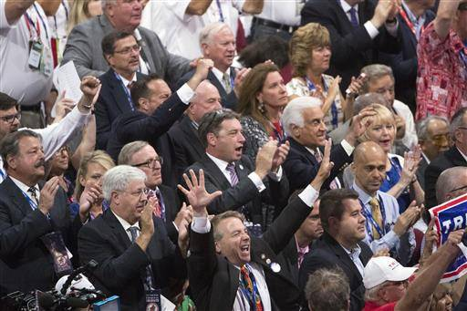 Members of the New York delegation cheer for Republican presidential candidate Donald Trump during the roll call at the Republican National Convention, Tuesday, July 19, 2016, in Cleveland. (AP Photo/Evan Vucci)