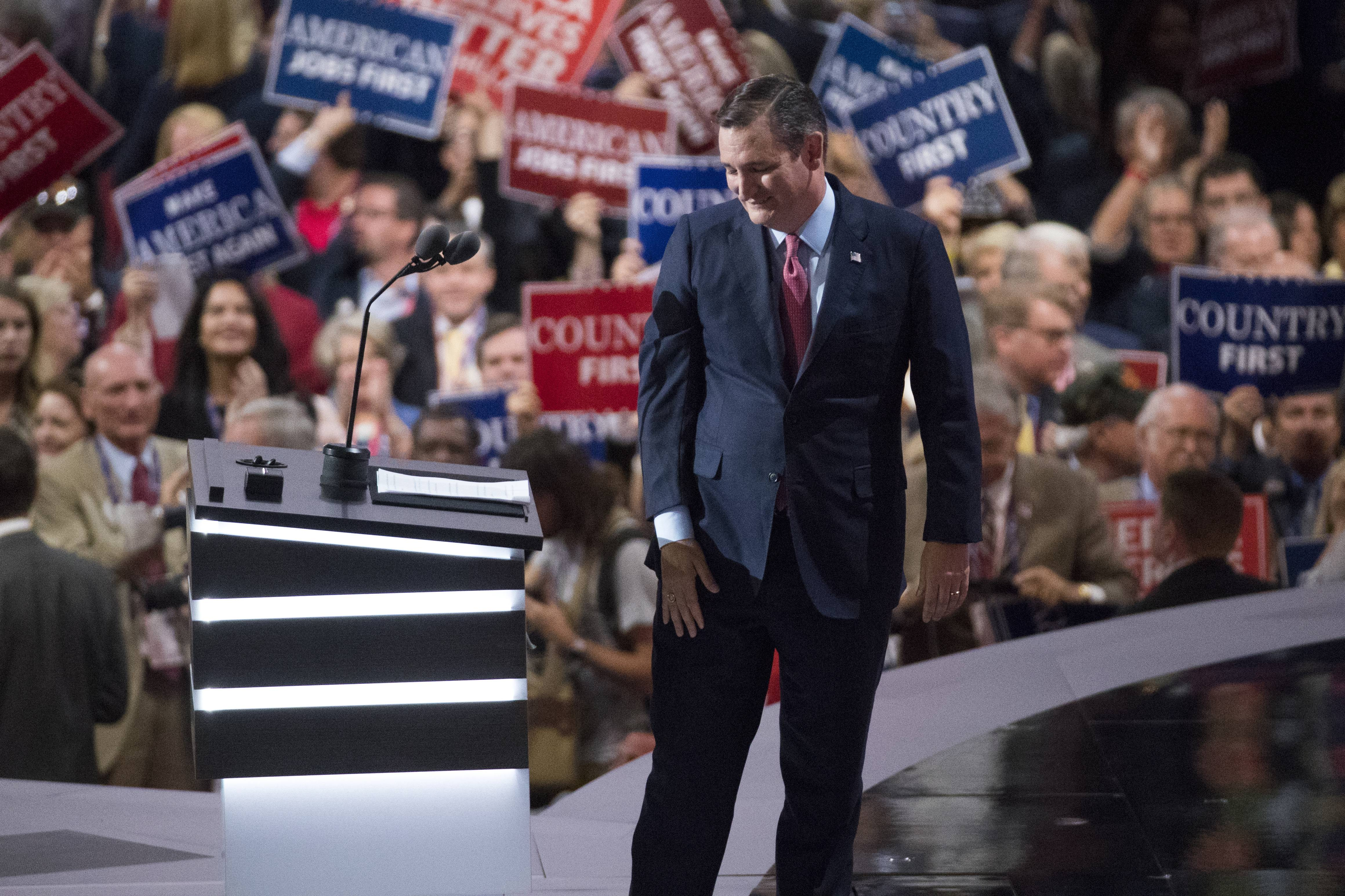 Sen. Ted Cruz, R-Texas, walks from the podium and receives some boos after speaking during the Republican National Convention Wednesday night.