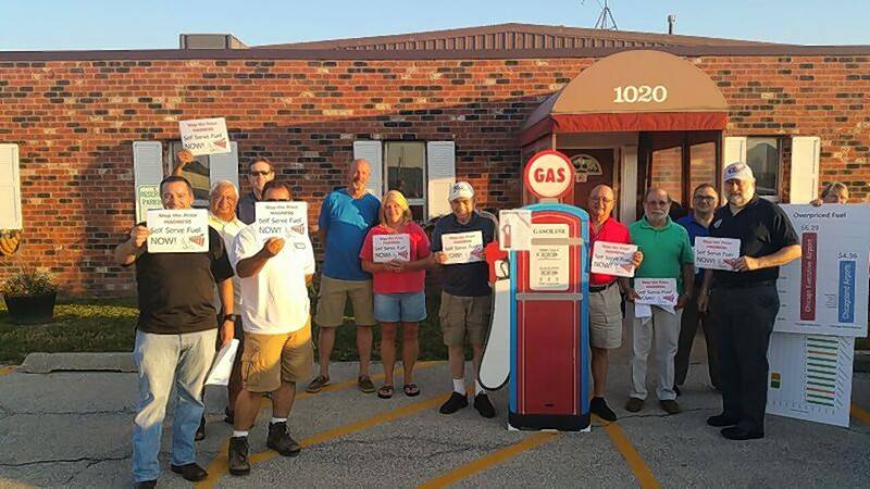 "Supporters of a self-service fuel pump at Chicago Executive Airport came to Wednesday's board meeting with signs reading ""Stop the price madness, self-service fuel NOW!"" Airport board members voted against any change, saying the pump wouldn't align with the airport's standards."
