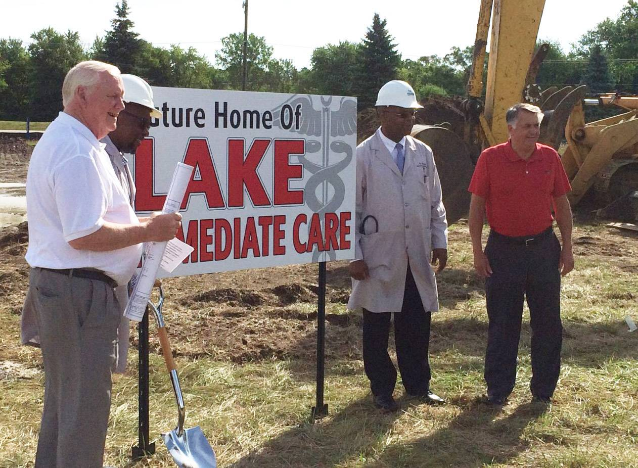 From left, construction manager Bo Strom, Dr. Eberechukwu Ibe, Dr. Reginald Ebirim and Mayor Charles Amrich pose for commemorative photos Friday where a new Lake Immediate Care facility is being built in Island Lake.