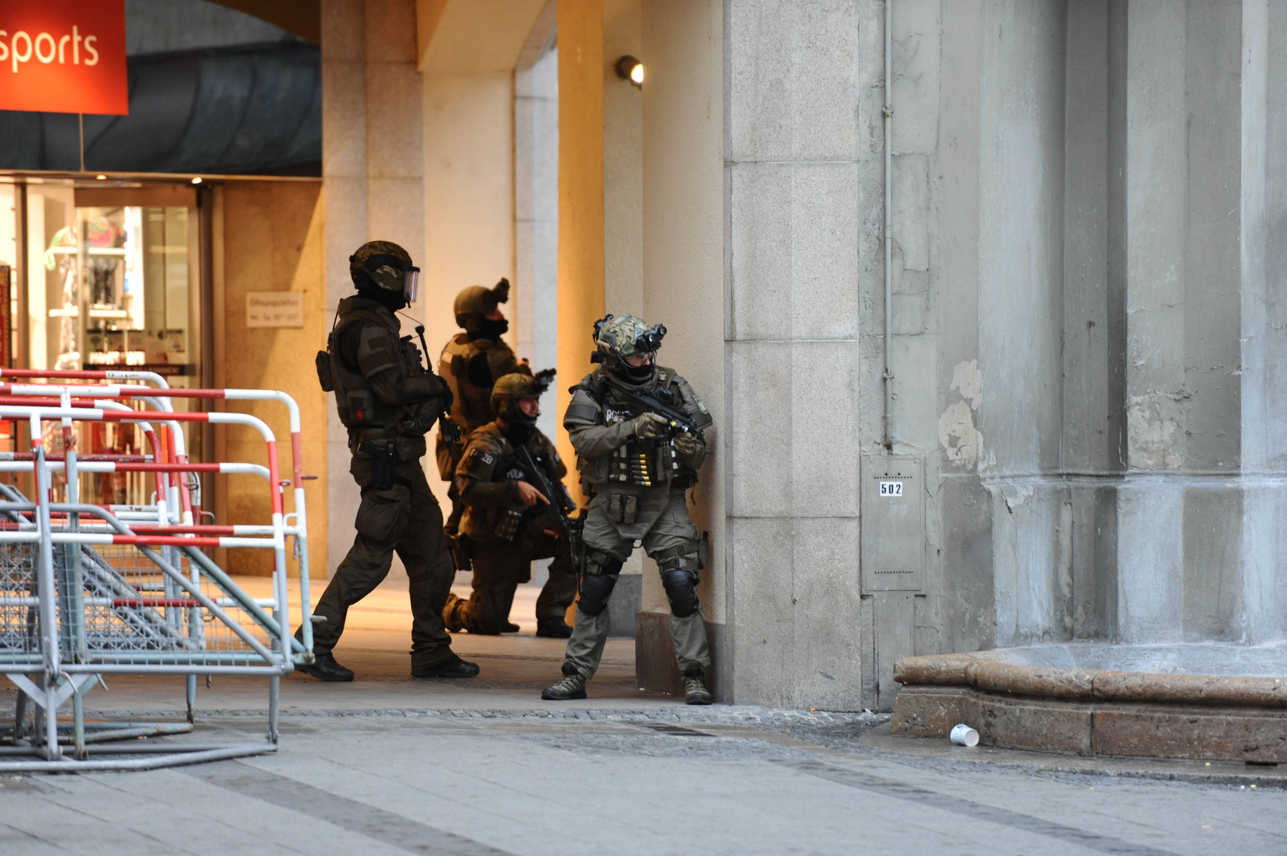 Heavily armed police forces operate at Karlsplatz (Stachus) square after a shooting in the Olympia shopping center was reported in Munich.