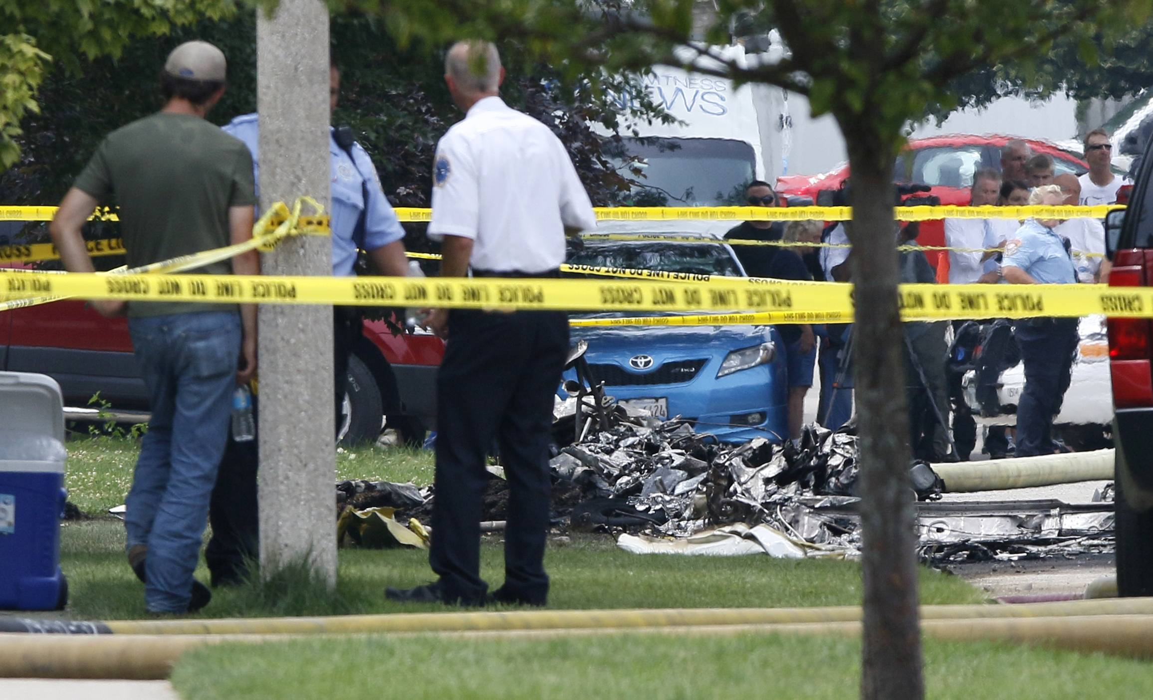 Authorities cordoned off the wreckage after a plane crashed Thursday at Chestnut Hill Road and Bedford Drive in Plainfield near the Joliet border.