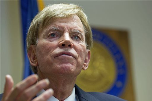 "CORRECTS MONTH - Former Ku Klux Klan leader David Duke talks to the media at the Louisiana Secretary of State's office in Baton Rouge, La., on Friday, July 22, 2016, after registering to run for the U.S. Senate, saying ""the climate of this country has moved in my direction."" Duke's candidacy comes one day after Donald Trump accepted the GOP nomination for president, and Duke said he's espoused principles for years that are similar to the themes Republicans are now supporting in Trump's campaign, on issues such as immigration and trade."