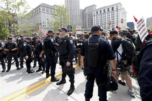 Law enforcement officers gather in Public Square on Thursday, July 21, 2016, in Cleveland, during the final day of the Republican convention.