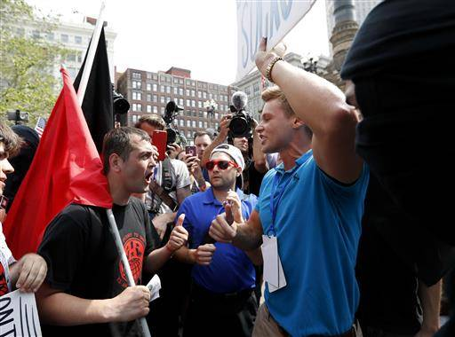 Protesters argue in Public Square on Thursday, July 21, 2016, in Cleveland, during the final day of the Republican convention.