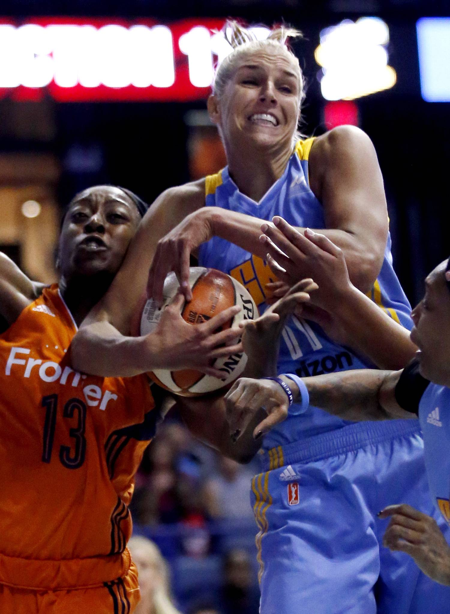 Chicago Sky forward Elena Delle Donne, right, and Connecticut Sun center Chiney Ogwumike compete for a rebound during the first half of a WNBA basketball game Friday, July 22, 2016, in Rosemont, Ill.