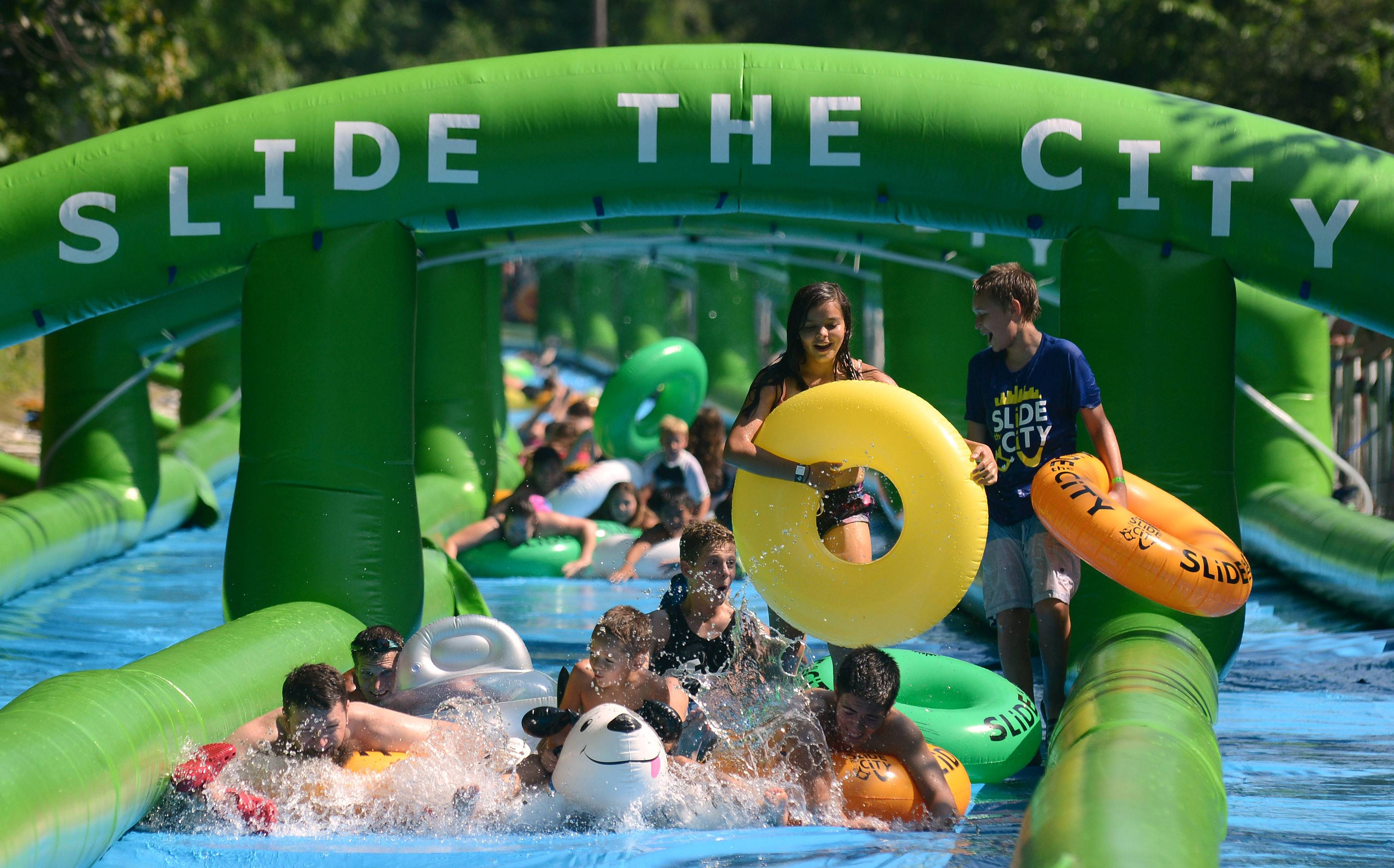 Slide the City installs a temporary 1000-foot water slide in Carpentersville on Saturday, July 23, and then in Chicago on July 30.