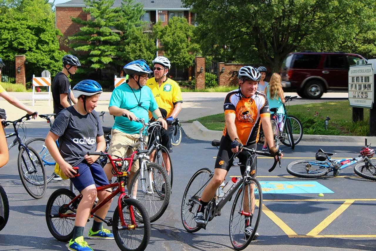 Elk Grove Village Mayor Craig Johnson led a group of about 75 residents on a leisurely bike ride Saturday around the village.