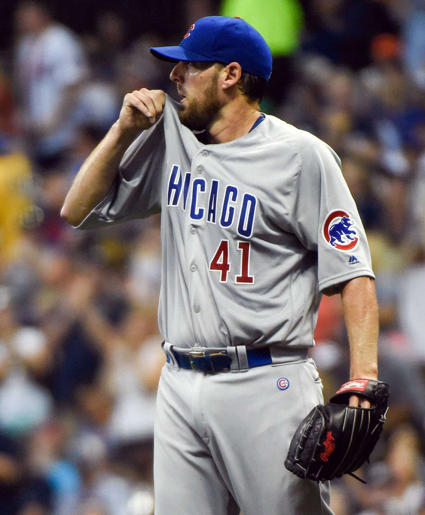 Cubs starting pitcher John Lackey reacts after giving up a 2-run home run to Milwaukee Brewers' Jonathan Lucroy during the first inning Saturday.