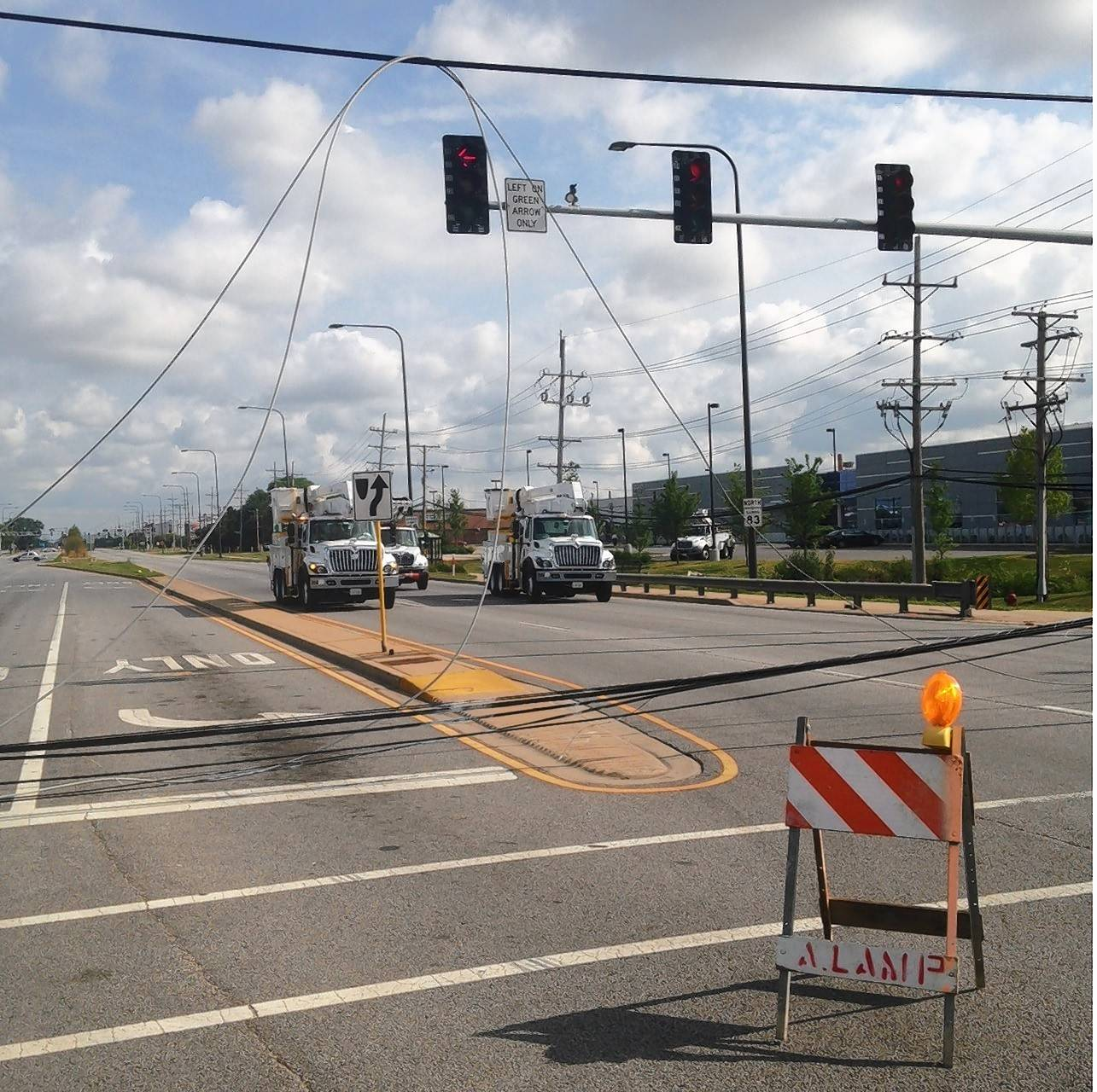 Downed electrical wires blocked Ill. Hwy. 83 at Devon Avenue in Elk Grove Village for about seven hours on Saturday. Officials aren't sure what caused the wires to fall on the pavement.