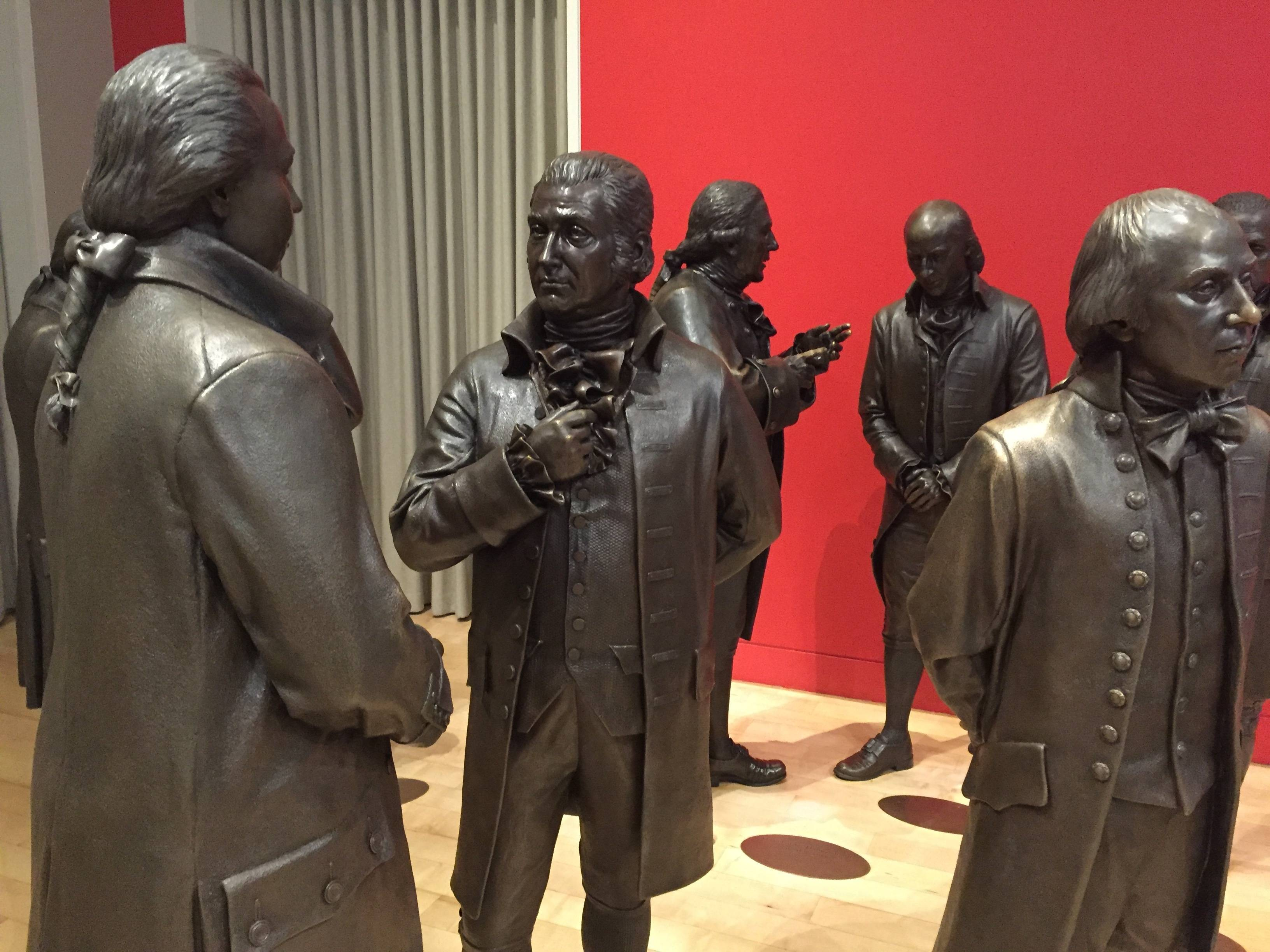 See life-size bronze sculptures of the signers of the U.S. Constitution in the Signers' Hall at the National Constitution Center. The room is designed to give visitors a sense of what it was like for the Founding Fathers to huddle in a room debating and writing the famous document.