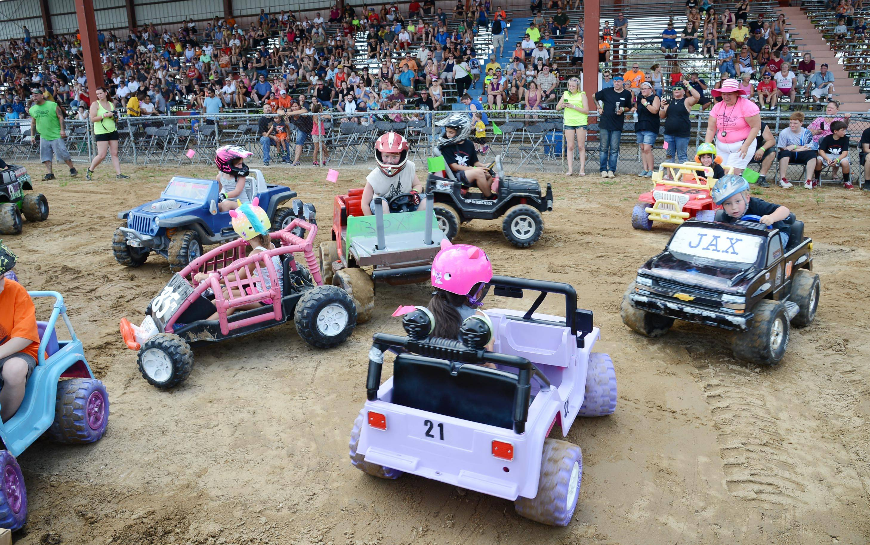 At right, About a dozen children compete in the Power Wheels Demo Derby Sunday at the Kane County Fair in St. Charles. The plastic, electric toy car event was won by Liliana Delao, 5, of Franklin Park, in the foreground in her purple Jeep.