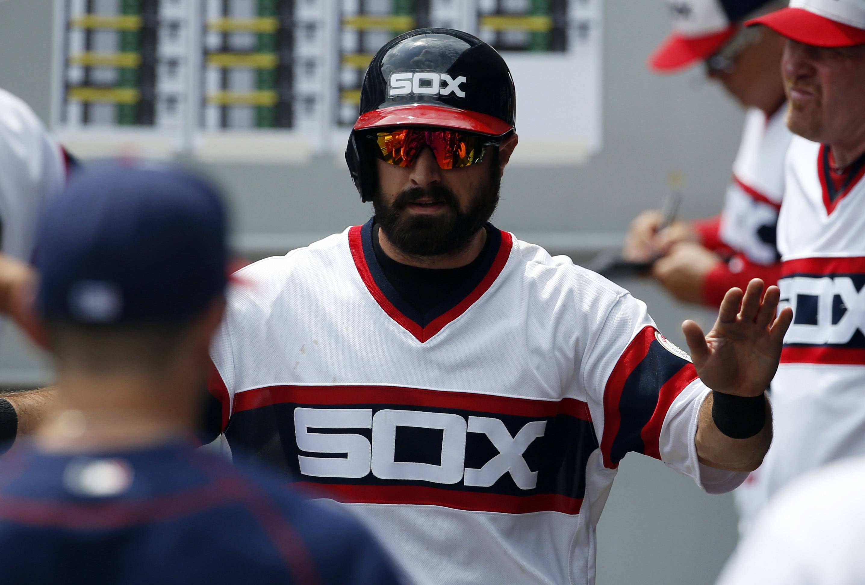 Chicago White Sox's Adam Eaton celebrates with teammates in the dugout after scoring on a single hit by Jose Abreu during the first inning of a baseball game against the Detroit Tigers, Sunday, July 24, 2016, in Chicago. (AP Photo/Nam Y. Huh)