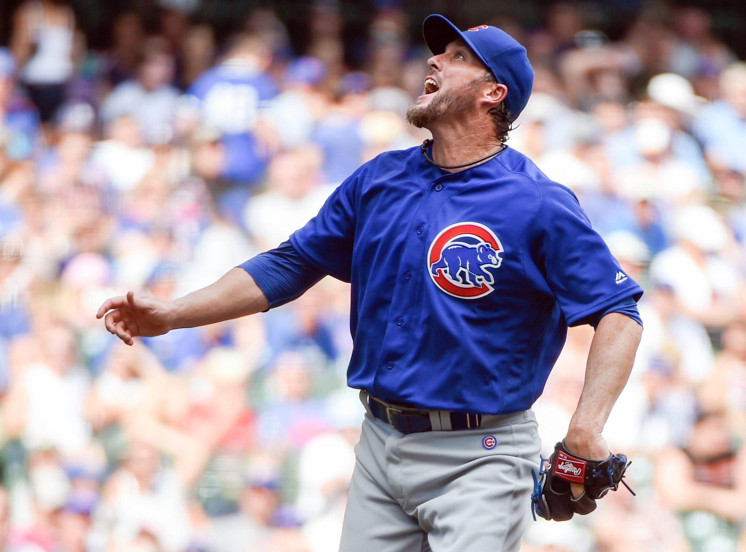 Chicago Cubs pitcher Joe Nathan reacts after a throw during the sixth inning of a baseball game against the Milwaukee Brewers, Sunday, July 24, 2016, in Milwaukee. (AP Photo/Benny Sieu)