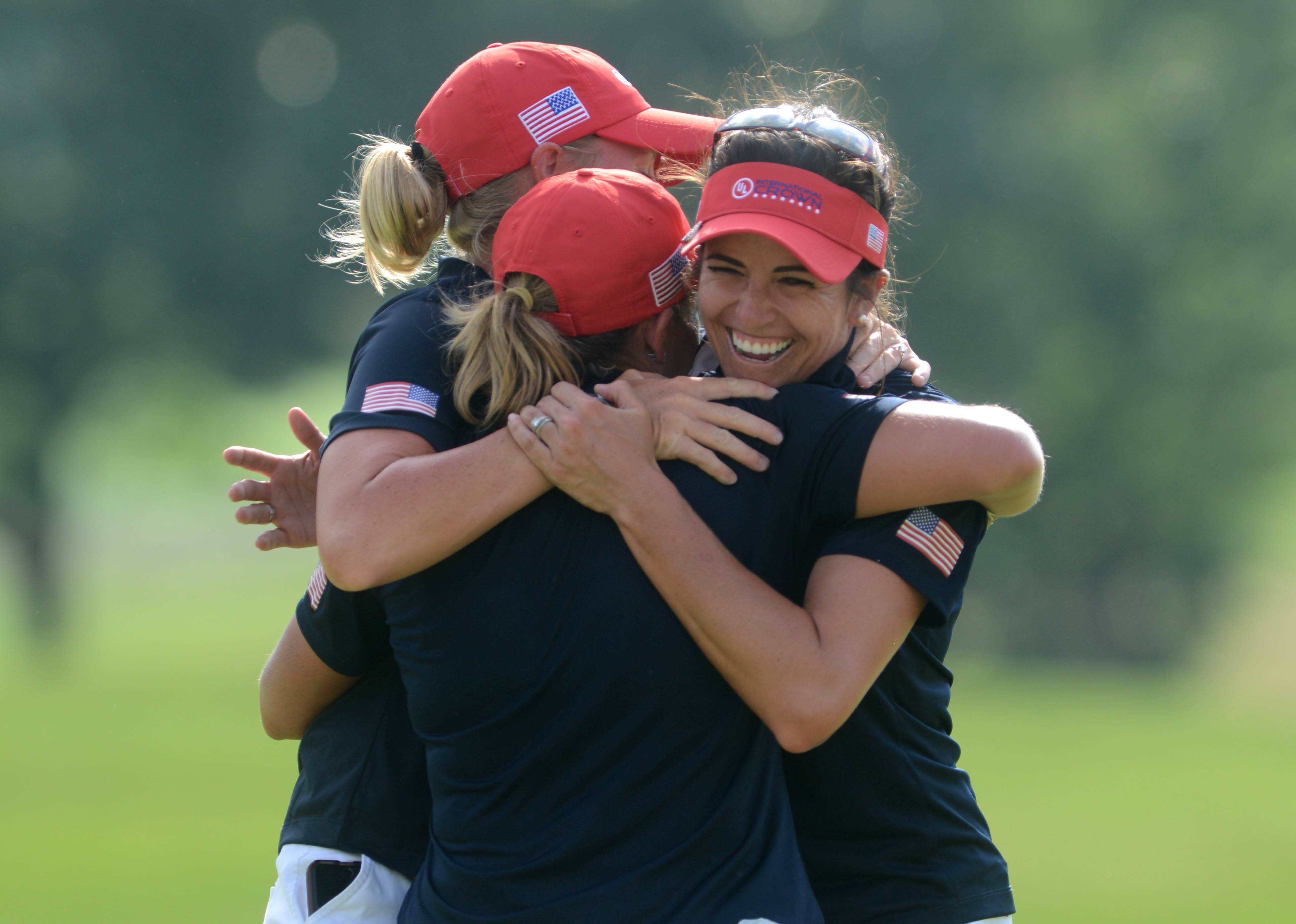 Morgan Timms/mtimms@dailyherald.com Stacy Lewis, Gerina Piller and Cristie Kerr embrace after Kerr's win against England's Melissa Reid and the realization sinks in that they have won the UL International Crown women's golf tournament Sunday at the Merit Club in Gurnee.
