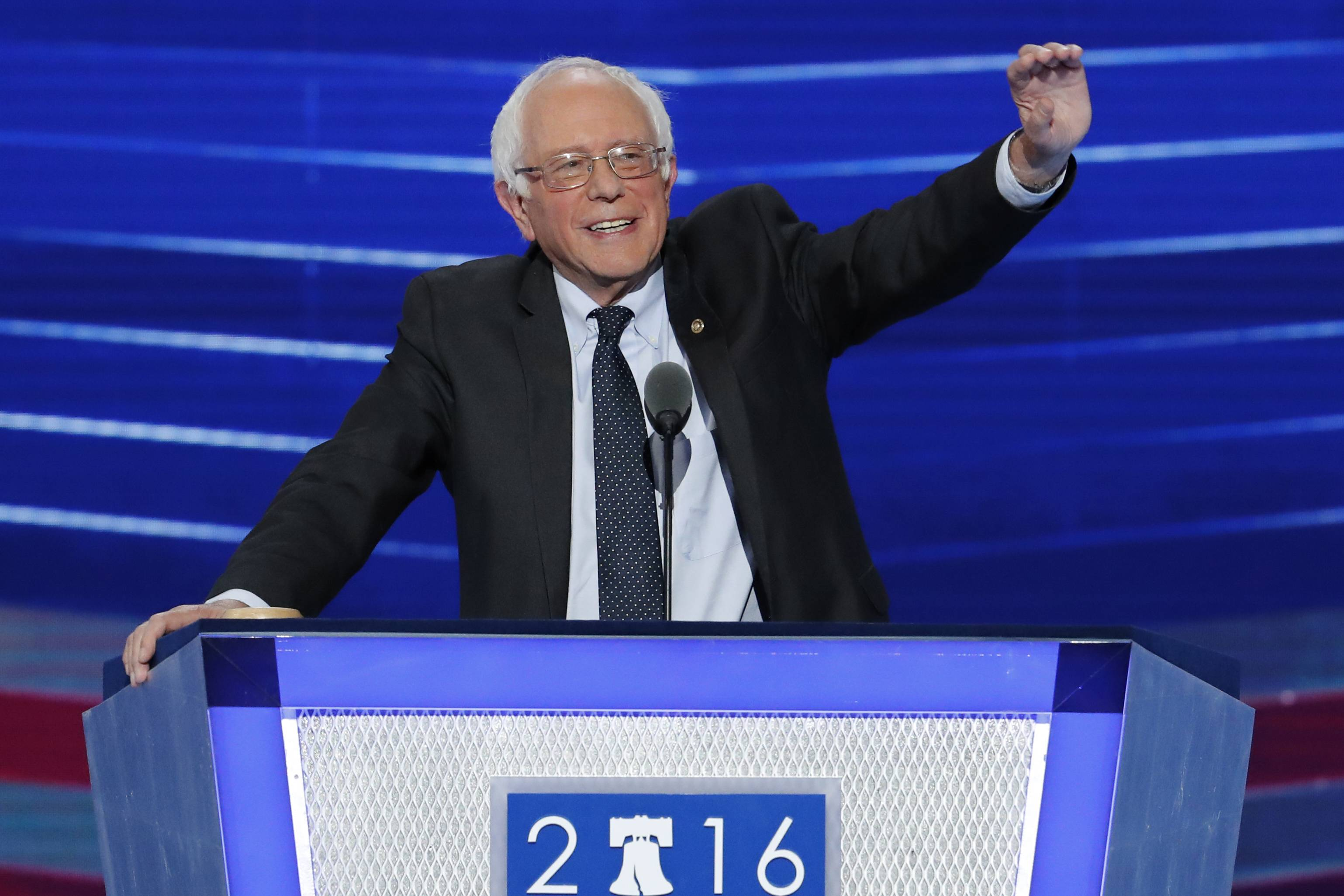 Former Democratic presidential candidate, Sen. Bernie Sanders, I-Vt., waves to delegates before speaking during the first day of the Democratic National Convention in Philadelphia, Monday, July 25, 2016.