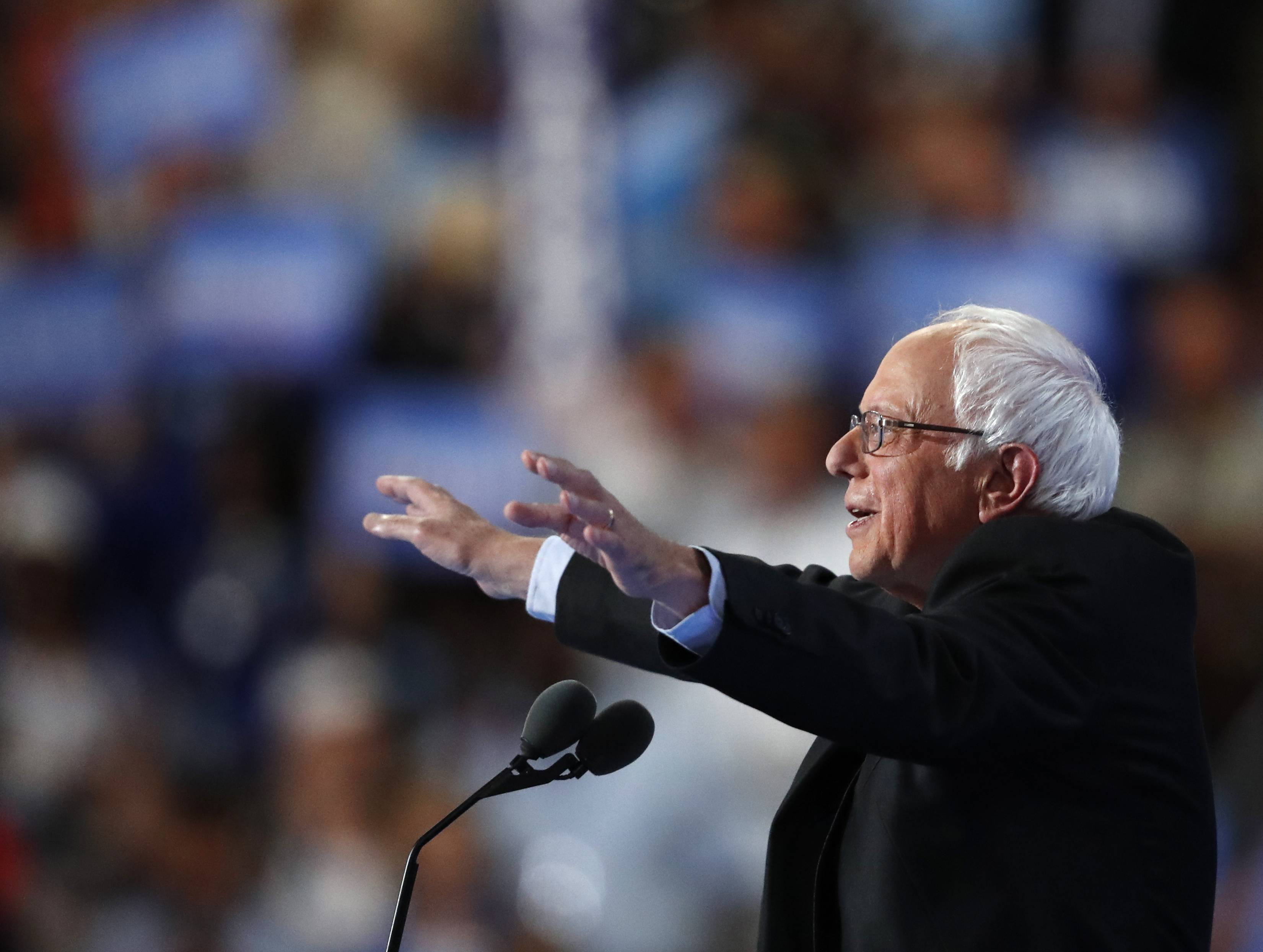 Former Democratic Presidential candidate, Sen. Bernie Sanders, I-Vt., gestures as he speaks during the first day of the Democratic National Convention in Philadelphia , Monday, July 25, 2016.