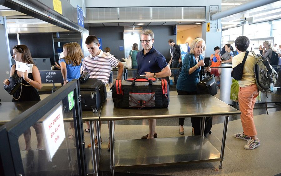 Passengers enter checkpoint 8 in Terminal 3 at O'Hare.